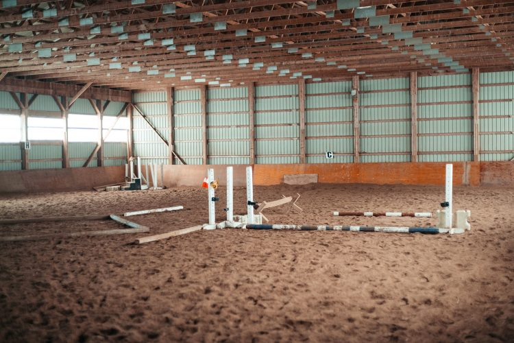 Interior of riding building, jumping obstacle course